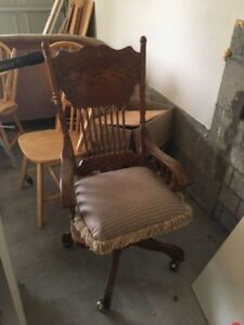 Antique swivel chair with cushion