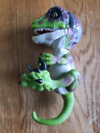 Dinosaur fingerling toy.