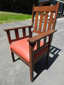 antique arts and craft oak chair..new leather seat
