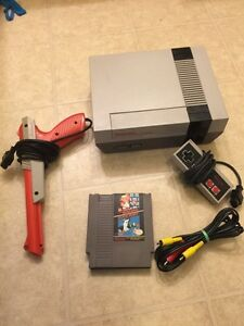 NES system with gun and Mario game