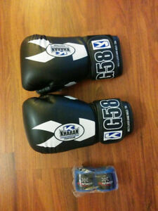 Boxing gloves and shin pads - boxing and muay thai
