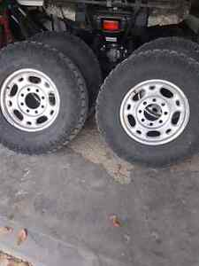 4 Chevrolet rims and tires off of 06 chev duramax  Regina Regina Area image 1