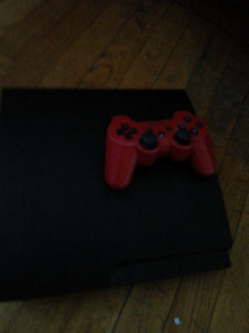 Selling my ps3 two red  controllers wireless withcharger 6games