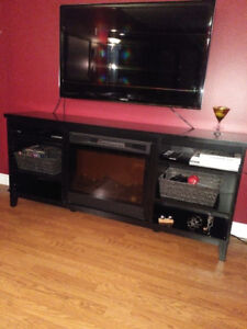 Black unit with Fireplace and shelves