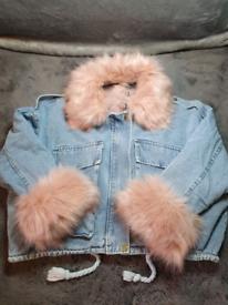 Denim jacket with pink faux fur