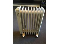 """Oil heater 2 kW radiator very low on electricity. RRP £90 18"""""""