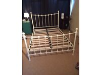 Ivory metal framed double bed for sale.