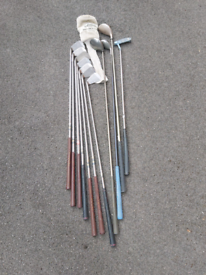 A selection of 11 golf clubs and ball collector.