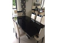 The Savina/Ebony Collection Table and Chairs