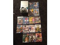 Silver Sony ps2 console with games