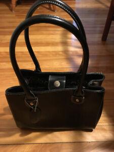 Women's handbags in pristine condition