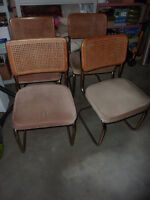 4 vintage chairs with metal frame and caning on back