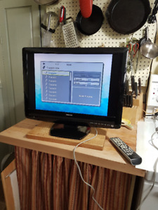 Television with built in DVD/CD player and remote.