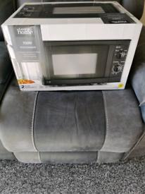 Bran new black microwave