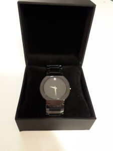 Movado men watch, look like brand new, no scrathes for 500 CAD
