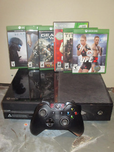 Xbox One with games, and 1 year xbox gold, and kinect