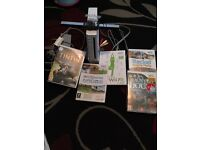 Wii console with stand and sensor and five games