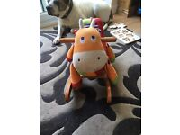 Wooden rocking horse with toy cow/horse soft seated