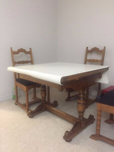 wood dinning table with four chairs