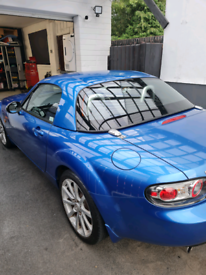 Mazda MX5 Sport, 2.0, 6 Speed with a hard top.