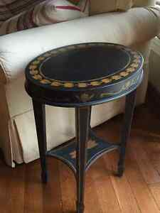 Unique table. Antique black oval chair side table
