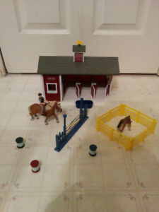 Breyer horse stable and 2 horses with rider, $35