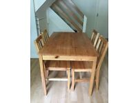 Wooden table + four chairs