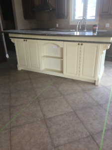 WOOD ISLAND WITH GRANITE COUNTER TOP