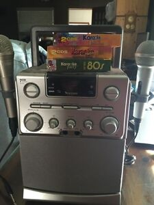 Venturer karaoke machine with 2 mics and 6 CDs