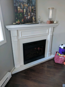 Electric fireplace with white wood corner insert