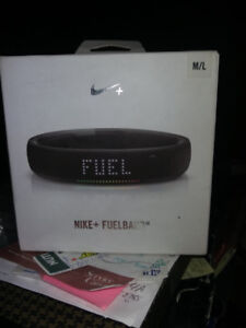 Nike + Fuelband Exercise Tracker and man, it's fit!