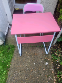 Pink desk and folding chair