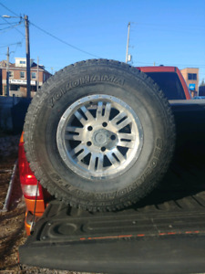 3 265/75/16 Tires and 4 Rims