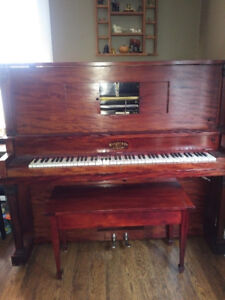 Player piano with rolls of music