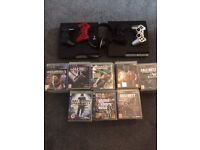 2 working PS3 slims + 4 genuine controllers and 76 games + camera and px3 wireless headset