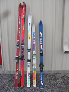 FIVE PAIRS OF * USED * SKIS