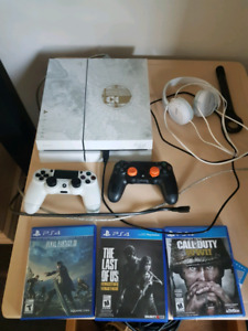 White PS4 + 2 remotes + games $370 obo