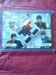 Carte de hockey 4 star memorablia numéroter sur/25 4jersey 2 clr