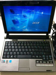 Emachines c2d 1.6ghz, 80gb HD, 1gb Ram - Win 7 Pro, office