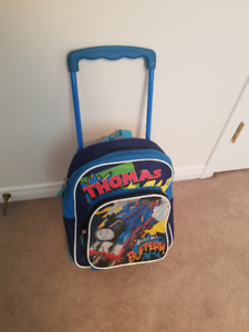Thomas backpack luggage with rollers and handle.