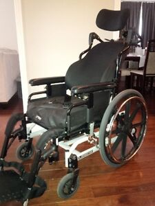Reclining wheelchair with head and foot rests