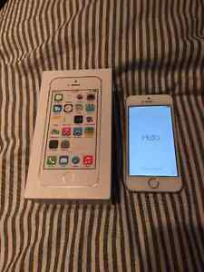 Gold iPhone 5s 16GB with newly replaced charger and three cases