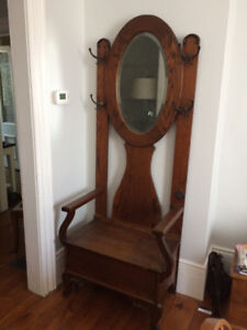 Antique hall tree with mirror and storage under seat
