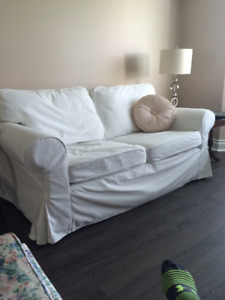 IKEA loveseat with white and brown slipcovers