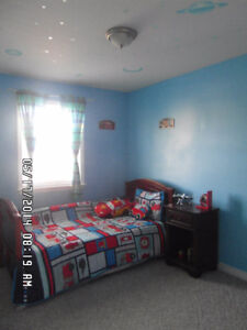 Twin bed mattress and night table