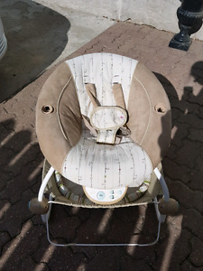 Baby rocker has music and vibration