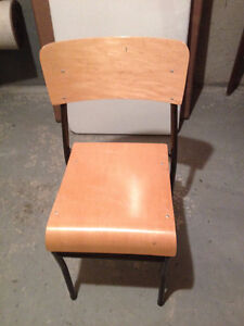 Four wood stacking chairs