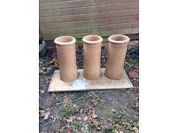Unused beige chimney pots