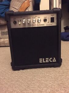 Eleca guitar amp and two cords