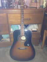Epiphone acoustic guitar.